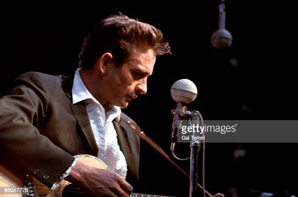FESTIVAL Photo of Johnny CASH Johnny Cash performing on stage