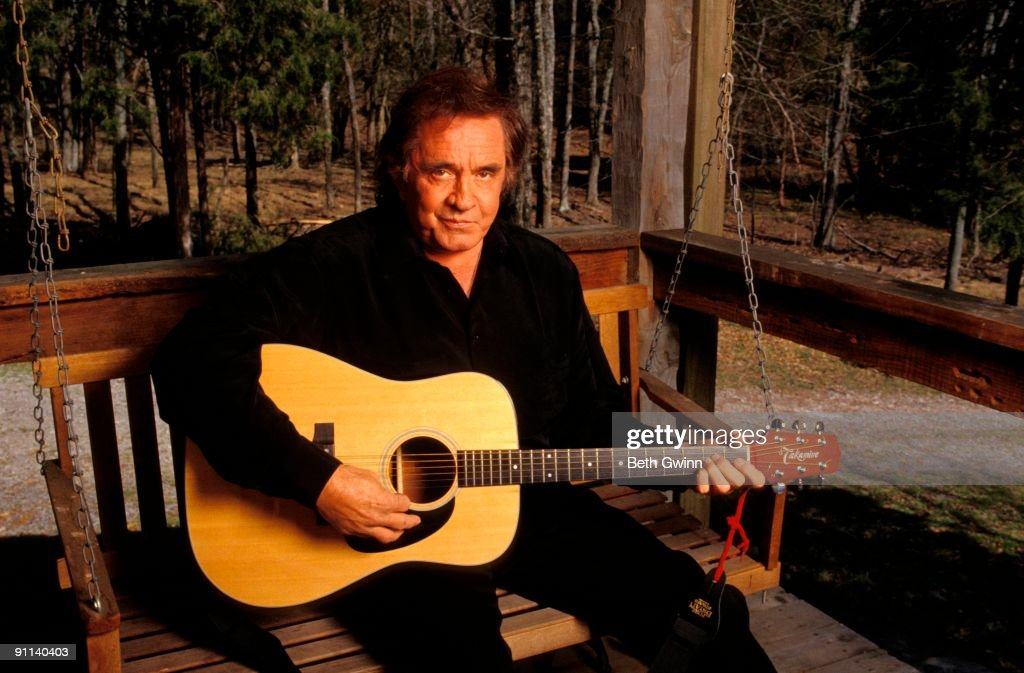 NASHVILLE Photo of Johnny CASH, Posed portrait of Johnny Cash with Takamine acoustic guitar