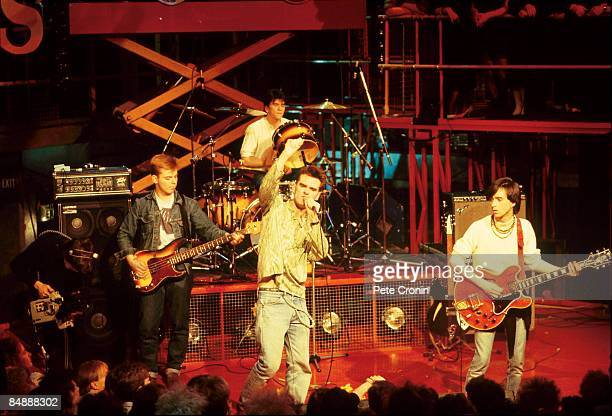 Photo of Johnny MARR and MORRISSEY and SMITHS and Andy ROURKE and Mike JOYCE LR Andy Rourke Mike Joyce Morrissey Johnny Marr performing live on The...