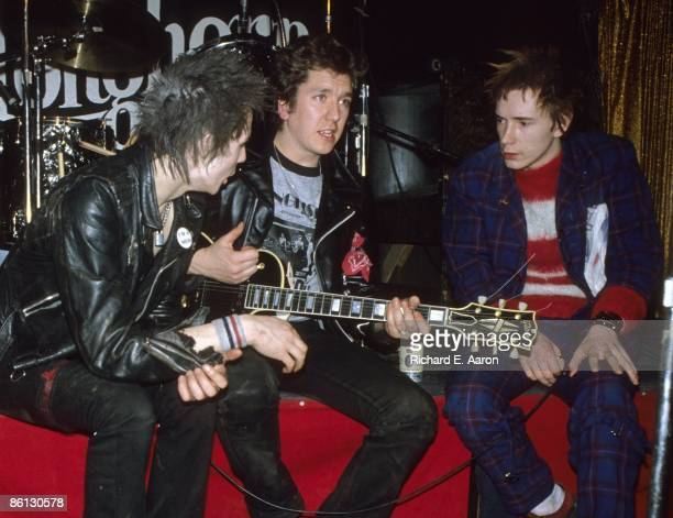 TEXAS Photo of Johnny ROTTEN and Steve JONES and Sid VICIOUS and SEX PISTOLS Sid Vicious Steve Jones Johnny Rotten posed group shot onstage at the...