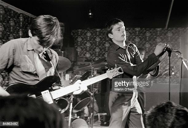 Photo of JOY DIVISION Bernard Sumner Ian Curtis performing live onstage at Bowdon Vale Youth Club