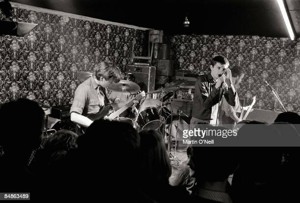 Photo of JOY DIVISION Bernard Sumner Ian Curtis Peter Hook performing live onstage at Bowdon Vale Youth Club