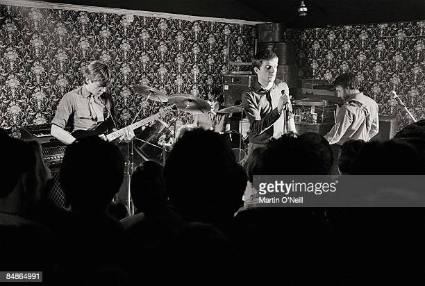 Photo of JOY DIVISION Bernard Sumner Stephen Morris Ian Curtis Peter Hook performing live onstage at Bowdon Vale Youth Club