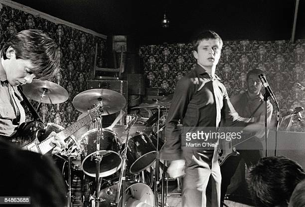 Photo of JOY DIVISION LR Bernard Sumner Ian Curtis Peter Hook performing live onstage at Bowdon Vale Youth Club