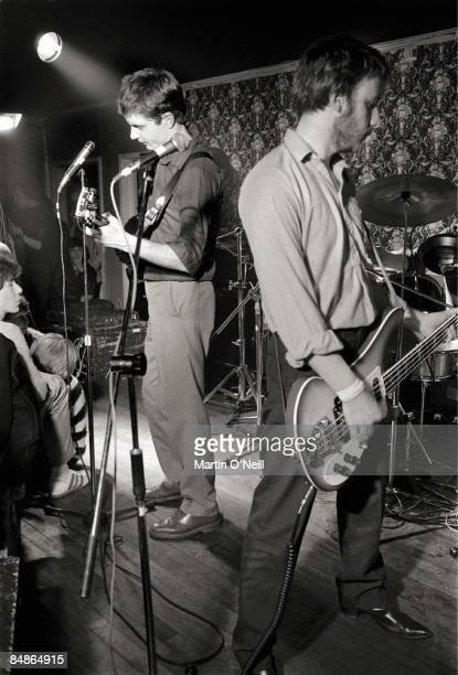 Photo of JOY DIVISION LR Ian Curtis Peter Hook performing live onstage at Bowdon Vale Youth Club