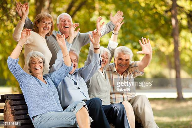 Photo of joyful group of senior people in park
