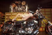HALL Photo of JUDAS PRIEST and Rob HALFORD Rob Halford performing live onstage with motorbike licking fuel tank