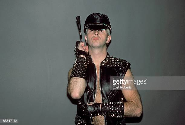 Photo of JUDAS PRIEST and Rob HALFORD Rob Halford posed wearing leather holding whip