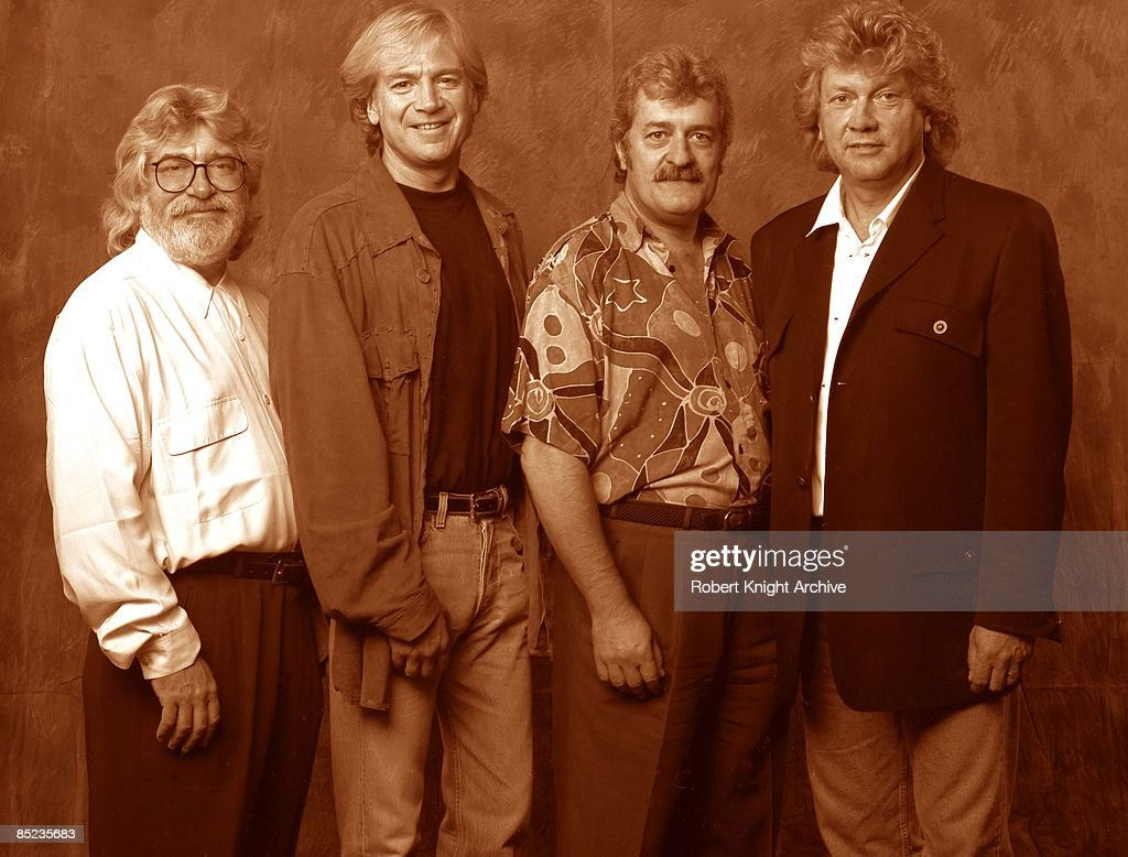 HOLLYWOOD Photo of Justin HAYWARD and MOODY BLUES and Graeme EDGE and Ray THOMAS, L-R. Graeme Edge, Justin Hayward, Ray Thomas, John Lodge - posed, studio, group shot at Rockwalk induction