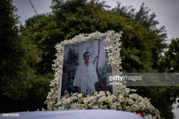 A photo of Kian Delos Santos on top of the hearse during his funeral on August 26 2017 in Caloocan city Philippines More than a thousand Filipinos...