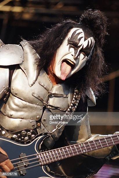 gene simmons tongue. festival photo of kiss and gene simmons simmons performing on stage sticking tongue out