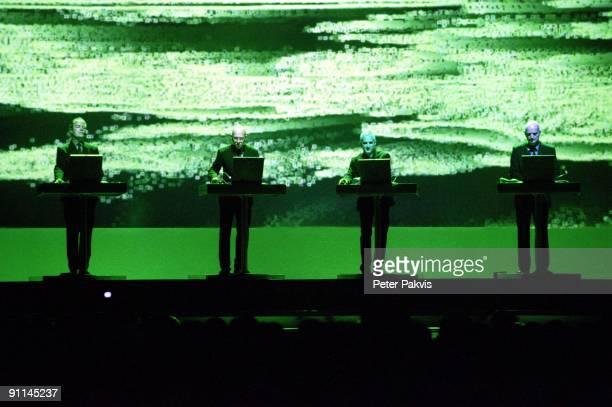 BELGIUM Photo of KRAFTWERK Kraftwerk Belgie Werchterrock Werchter 30 juni 2005 Pop electro tegen een meters hoge video projectie op de achtergrond...