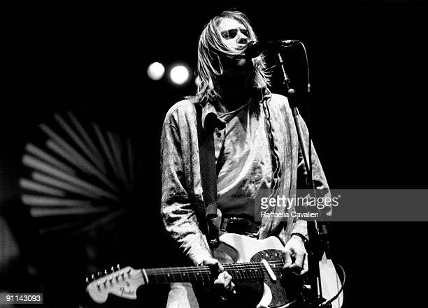 Photo of Kurt COBAIN and NIRVANA Kurt Cobain performing live onstage at Palasport Modena playing Fender Mustang guitar