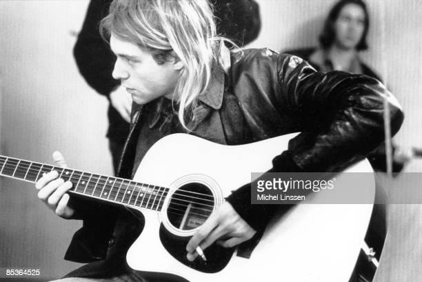 HILVERSUM Photo of Kurt COBAIN and NIRVANA Kurt Cobain recording in Hilversum Studios playing Takamine acoustc guitar holding cigarette