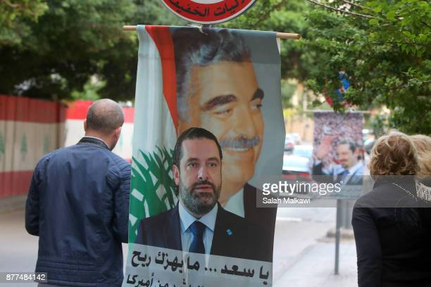 A photo of Lebanon's prime minister Saad Hariri is seen in a street as he makes a public appearance at his home 'Beit alWasat' November 22 2017 in...