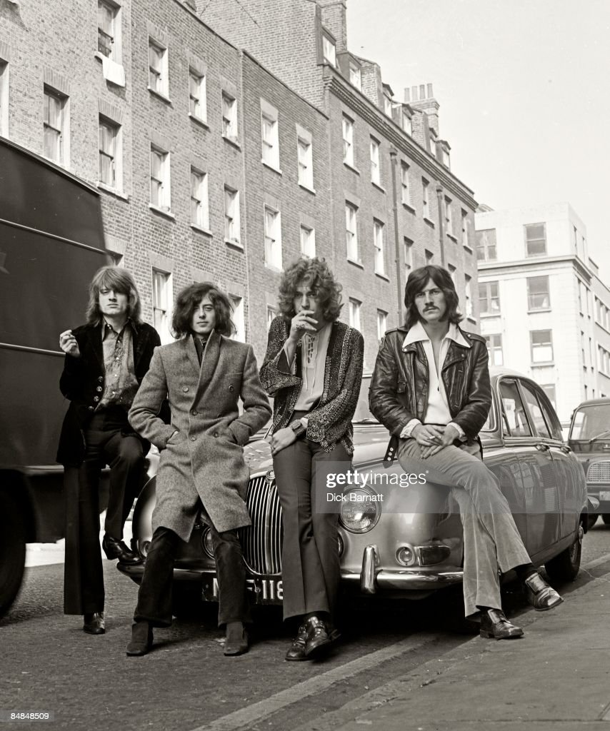 Photo of LED ZEPPELIN posed on a Jaguar car in a London street in December 1968 Left to right John Paul Jones Jimmy Page Robert Plant and John Bonham