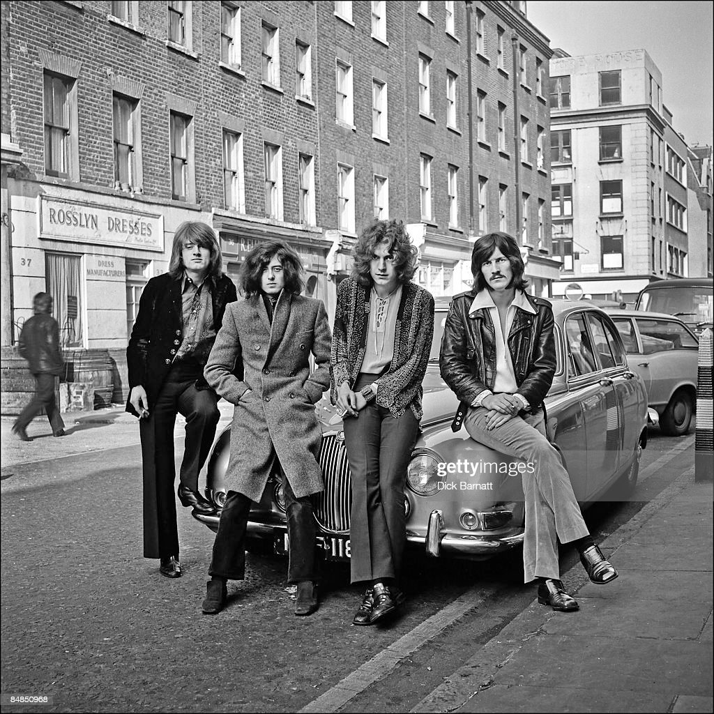 Photo of LED ZEPPELIN posed on a Jaguar car in London in December 1968 Left to right John Paul Jones Jimmy Page Robert Plant and John Bonham