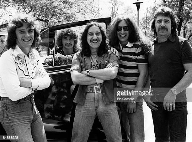 Photo of Lee KERSLAKE and Ken HENSLEY and Mick BOX and John WETTON and URIAH HEEP and David BYRON Posed group portrait LR John Wetton David Byron...
