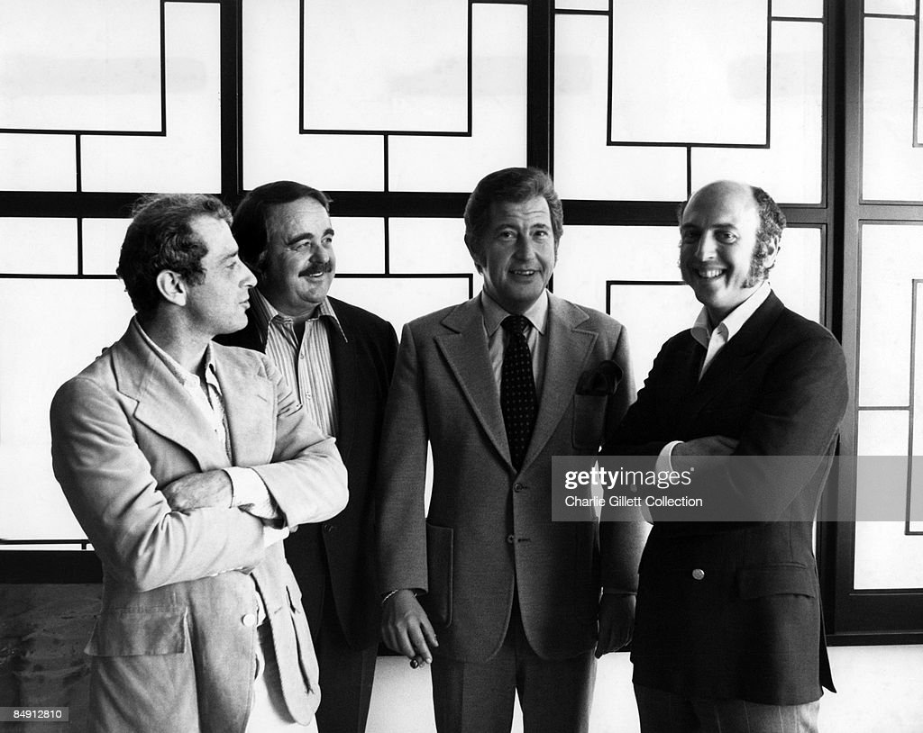 Photo of LEIBER & STOLLER; Posed with business associates L-R: Jerry Leiber, Hal Neely, Freddy Bienstock, Mike Stoller,