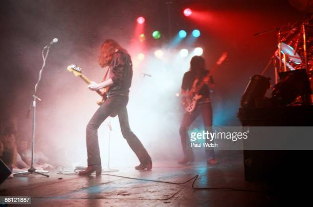 Photo of LEMMY and MOTORHEAD 'Fast' Eddie Clarke and Ian 'Lemmy' Kilmister performing on stage at the Electric Circus