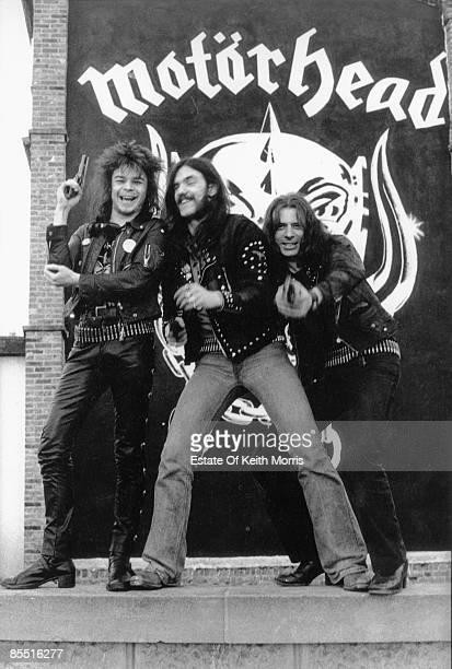 Photo of LEMMY and MOTORHEAD posed group shot LR Philthy Animal Lemmy 'Fast' Eddie Clarke