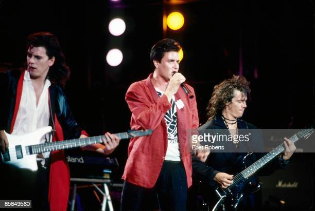 Photo of LIVE AID and DURAN DURAN John Taylor Simon Le Bon Andy Taylor performing live onstage at Live Aid