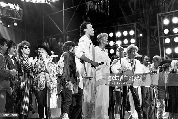 Photo of LIVE AID L to R Duran Duran Thompson Twins Lionel Richie Dionne Warwick Bob Dylan Peter Paul Mary