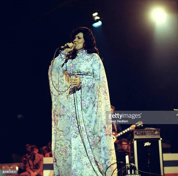 POOL Photo of Loretta LYNN Loretta Lynn performing on stage