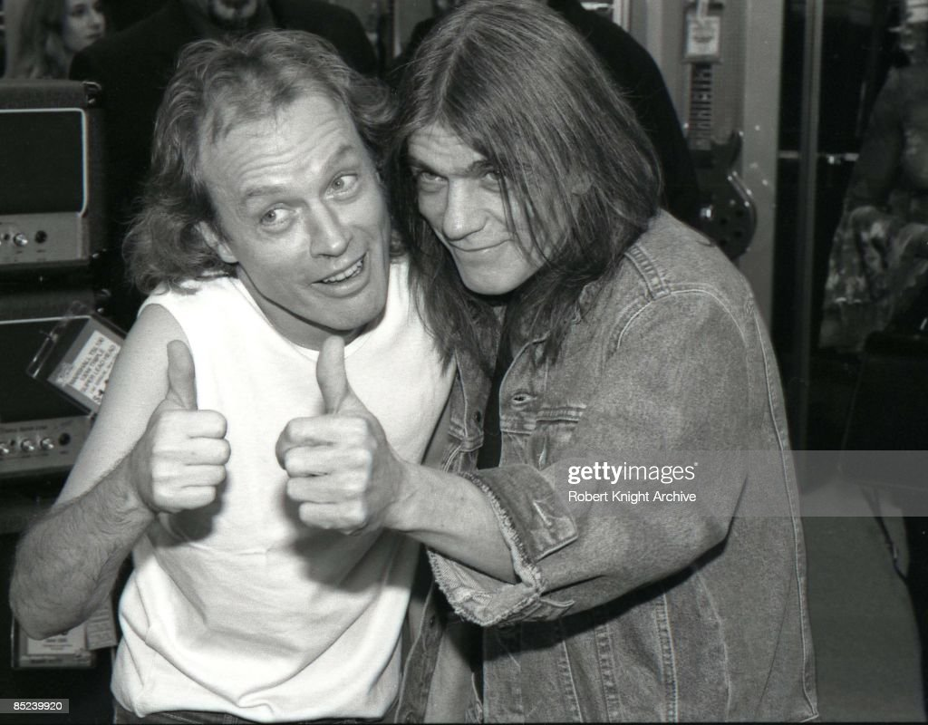 Photo of Malcolm YOUNG and AC/DC and Angus YOUNG and AC DC; Angus Young and Malcolm Young, posed at Rockwalk Induction, doing thumbs up, brothers
