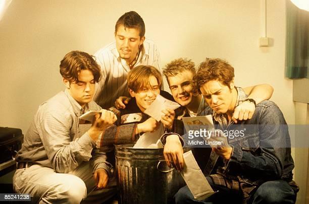 Photo of Mark OWEN and TAKE THAT and Robbie WILLIAMS and Gary BARLOW LR Robbie Williams Jason Orange Mark Owen Gary Barlow Howard Donald