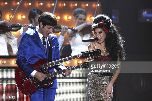 COURT Photo of Mark RONSON and Amy WINEHOUSE Mark Ronson performing on stage with Amy Winehouse twin necked guitar