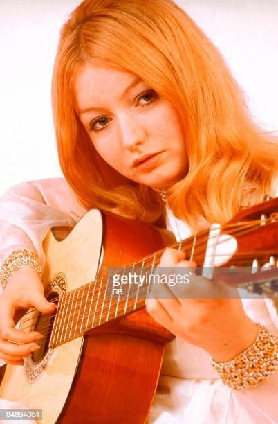 Photo of Mary HOPKIN Posed portrait of Mary Hopkin playing an acoustic guitar