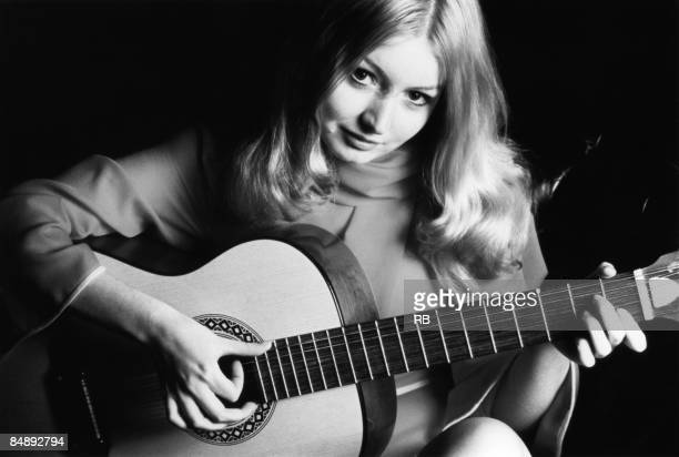 Photo of Mary HOPKIN Posed studio portrait of Mary Hopkin with an acoustic guitar