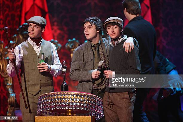 COURT Photo of Matt HELDERS and Nick O'MALLEY and Alex TURNER and ARCTIC MONKEYS The Arctic Monkeys on stage accepting the British Group Award LR...