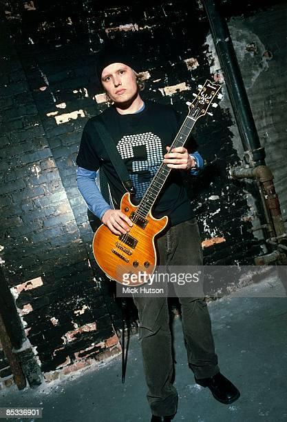 Photo of Matt ROBERTS and 3 DOORS DOWN Posed portrait of Matt Roberts full length Ibanez guitar