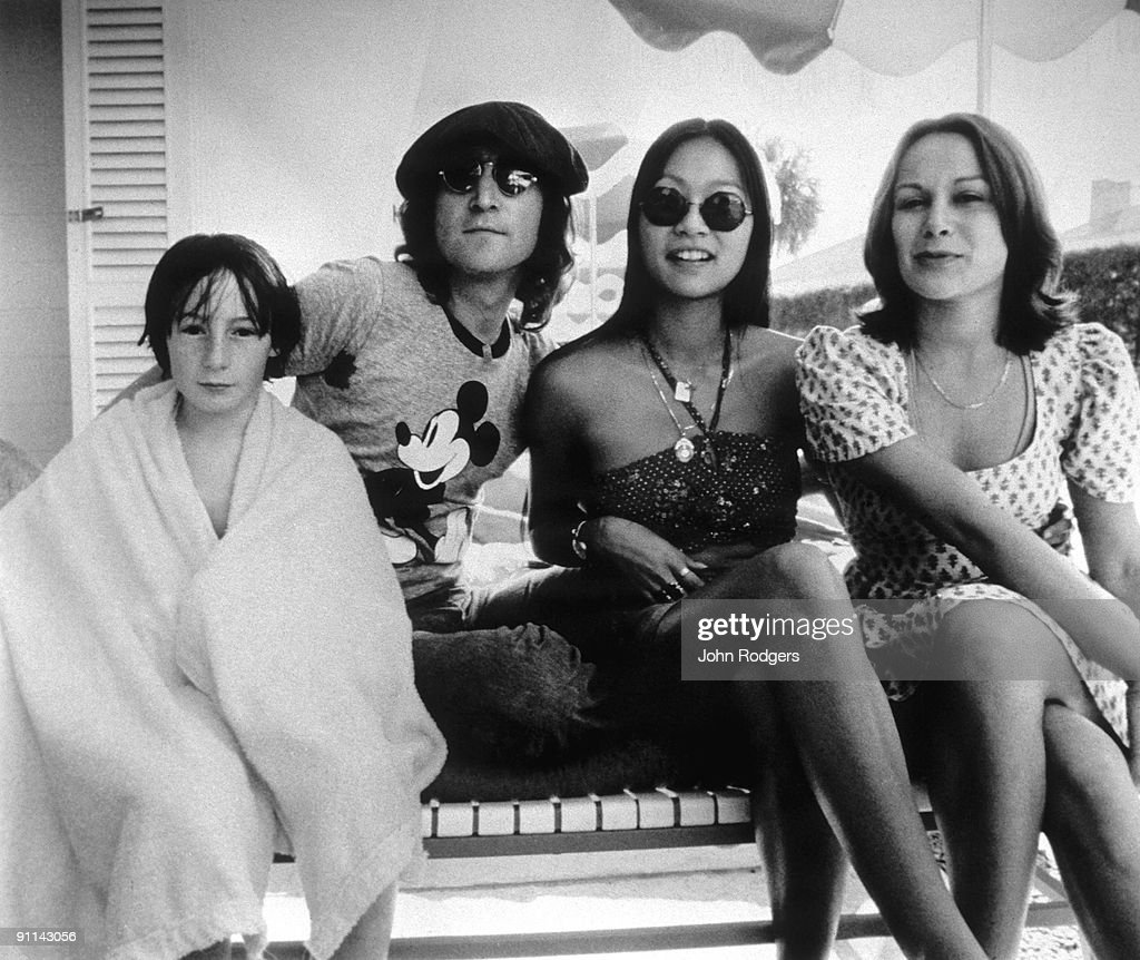 Photo of May PANG and Julian LENNON and John LENNON; L-R: Julian Lennon, John Lennon (wearing Mickey Mouse t-shirt), May Pang, ?