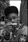 Photo of MC SHAN Posed portrait of MC Shan in the street bling