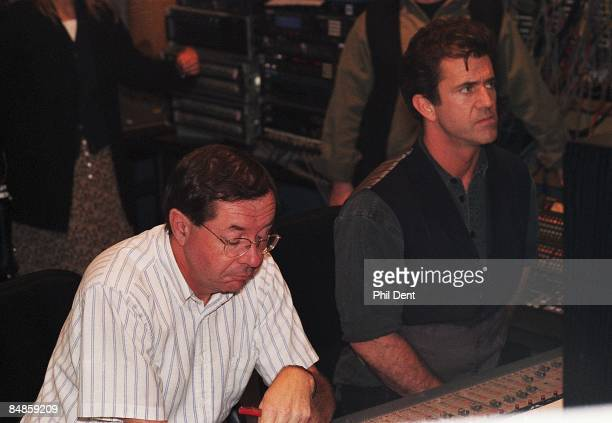 STUDIOS Photo of Mel GIBSON Mel Gibson sitting at mixing desk listening to soundtrack of Braveheart film