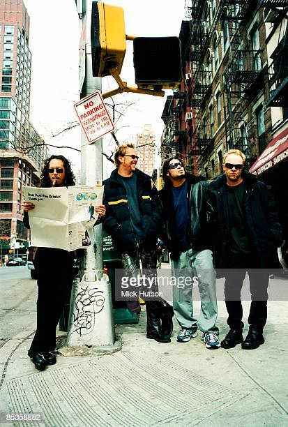 Photo of METALLICA and Lars ULRICH and James HETFIELD and Kirk HAMMETT and Robert TRUJILLO Posed full length group portrait in the street LR Kirk...