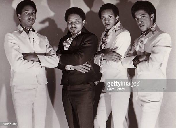 Photo of METERS and Art NEVILLE and George PORTER Jr and Leo NOCENTELLI and Joseph 'Zigaboo' MODELISTE Posed studio group portrait LR Joseph '...