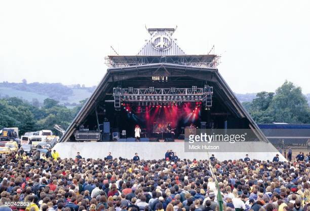 FESTIVAL Photo of MH1004_GLASTONBURY View of the original Pyramid Stage at Glastonbury Festival in the early 1990s with crowds in front watching