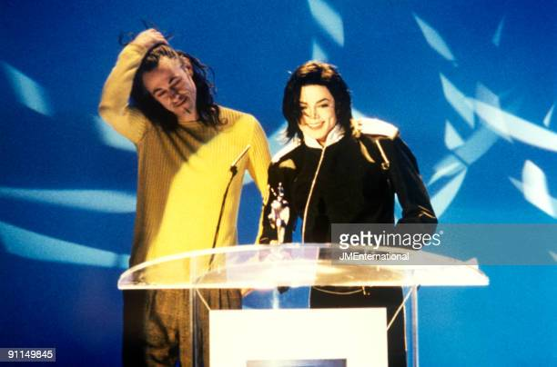 AWARDS Photo of Michael JACKSON and Bob GELDOF Bob Geldof presenting Artist Of A Generation award to Michael Jackson at The Brit Awards