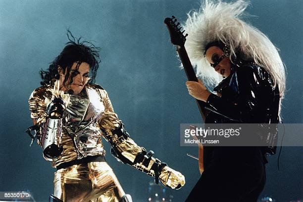 Photo of Michael JACKSON and Jennifer BATTEN Michael Jackson with Jennifer Batten performing live on stage at the Amsterdam Arena HIStory Tour