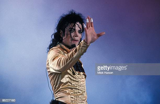 STADIUM Photo of Michael JACKSON Michael Jackson performing on stage hand out Dangerous Tour