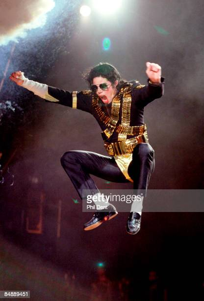 STADIUM Photo of Michael JACKSON Michael Jackson performing on stage jumping in the air Dangerous Tour