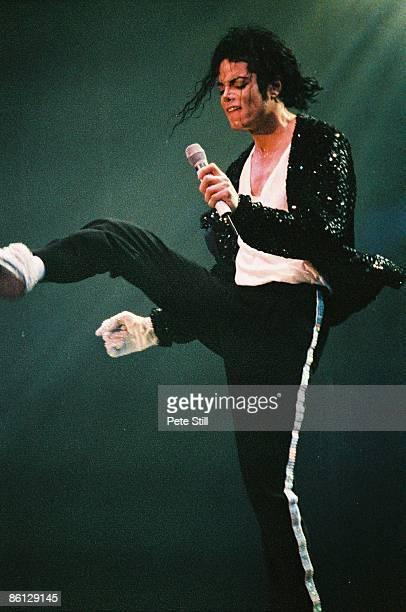 STADIUM Photo of Michael JACKSON Michael Jackson performing on stage leg in the air Dangerous Tour