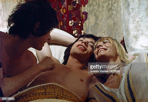 Photo of Mick JAGGER and Anita PALLENBERG and Michele BRETON LR Michele Breton Mick Jagger Anita Pallenberg on set of film Performance