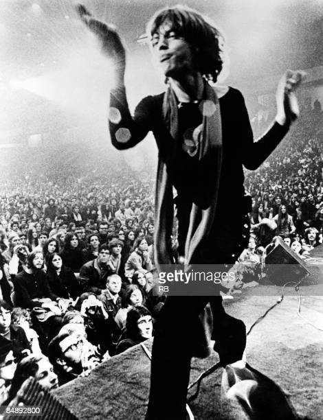 Photo of Mick JAGGER and ROLLING STONES Mick Jagger performing on stage audience in picture