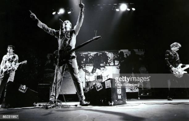 THEATRE Photo of Mick JONES and Paul SIMONON and Joe STRUMMER and CLASH LR Mick Jones Joe Strummer Paul Simonon performing live onstage White Riot...