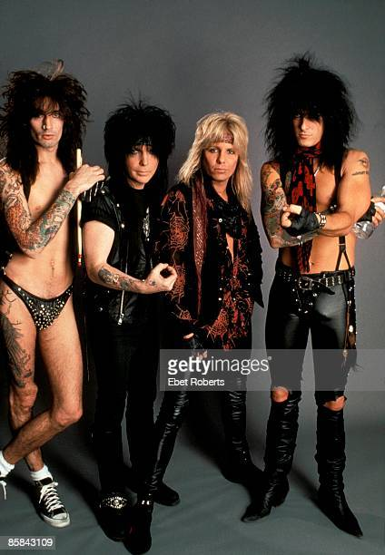Photo of Mick MARS and Tommy LEE and Nikki SIXX and MOTLEY CRUE and Vince NEIL Posed group shot stdio L R Tommy Lee Mick Mars Vince Neil Nikki Sixx